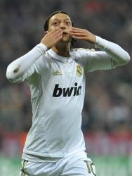 Madrid's Mesut Oezil celebrates scoring his side's first goal during the Champions League first leg semifinal soccer match in southern Germany, Tuesday, April 17, 2012.