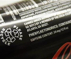 This soda can's label shows it contains 34 milligrams of caffeine; a teaspoon of caffeine powder can contain 1,600 milligrams.