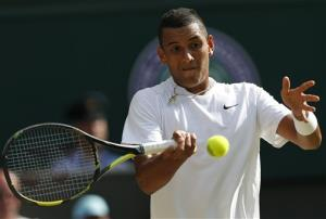 Nick Kyrgios of Australia plays a return to Rafael Nadal of Spain during their men's singles match at the All England Lawn Tennis Championships in Wimbledon, London, Tuesday July 1, 2014.