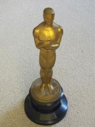 "This undated photo released by Briarbrook Auctions shows an Academy Award Oscar statue awarded for color art direction in 1942 to Joseph C. Wright for his work on ""My Gal Sal."""