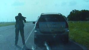 An Oklahoma officer attempts to persuade Luz Avilla to exit the vehicle..