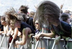 Music fans are headbanging as the Brazilian metal band Soulfly performs on stage during the Greenfield Open Air festival in Interlaken, Switzerland, on Saturday, June 13, 2009.