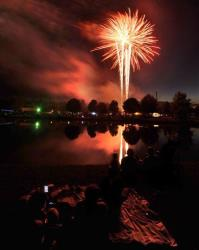 People watch a fireworks display to commemorate the Independence Day holiday, Thursday night, July 3, 2014, in Owensboro, Ky.