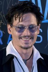 "Johnny Depp attends a promotional event for his movie ""Transcendence"" in Beijing on March 31, 2014."