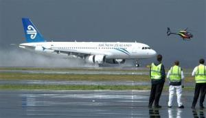 An Air New Zealand plane touches down in Auckland, New Zealand.