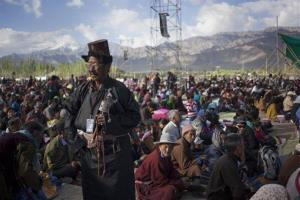 Buddhist devotees wait to listen to the Dalai Lama's teachings on the fifth day of Kalachakra near Leh, India yesterday.