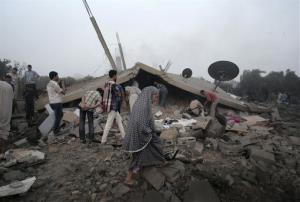 Palestinians try to salvage what they can of their belongings from the rubble of a house destroyed by an overnight Israeli airstrike in Gaza City Tuesday, July 8, 2014. Israel launched what could be a long-term offensive against the Hamas-ruled Gaza Strip on Tuesday, the military said, striking at least...