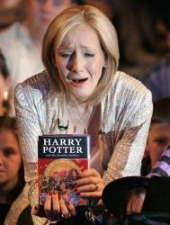 JK Rowling reacts during a photocall for the release of her latest Harry Potter book titled Harry Potter and the Deathly Hallows at the Natural History Museum in London, Friday July 20, 2007.