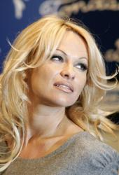 Pamela Anderson poses at the Brigitte Bardot Foundation in Paris, in this Feb. 14, 2008, file photo, during a  protest against seal hunting  in Canada.