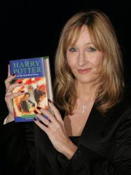 This July 15, 2005 file photo shows JK Rowling holding a copy of her latest book 'Harry Potter and the Half-Blood Prince' as she arrives at Edinburgh Castle in Scotland for its worldwide launch.