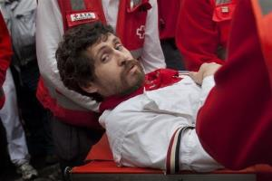 Bill Hillmann is carried on a stretcher after being gored.