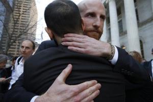 Plaintiffs challenging Utah's gay marriage ban Derek Kitchen, right, and partner Moudi Sbeity hug after leaving court in Denver in April.