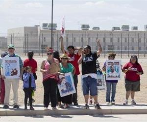 Supporters of the immigrant advocacy group, Puente Movement, hold a rally outside the immigration detention center in Eloy, Ariz.,  April 5, 2014.