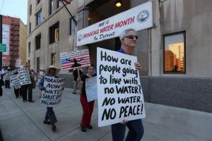 This photo taken May 30, 2014, shows protesters with Moratorium Now! rallying outside the Detroit Water Department against water shut-offs.