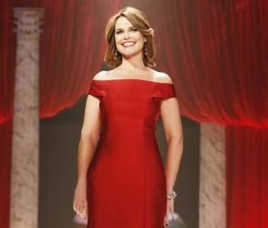 In this Feb. 6, 2013 file photo, Savannah Guthrie walks the runway at the Red Dress Collection 2013 Fashion Show in New York.
