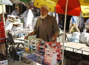 In this Thursday, Sept, 26, 2013 photo, Abdul Wasay, 75, sells toothbrushes and toothpaste on a busy street market In Kabul, Afghanistan, where he says he usually spends most of his days.