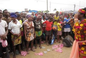 In this photo taken on July 8, 2014, Ebola advocacy group Crusaders for Peace, spokesperson Juli Endee, right, educates people on the deadly virus in Paynesville, east of the city  Monrovia, Liberia.
