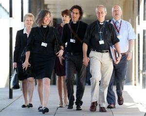 Archbishop of Canterbury Justin Welby, second right, and unidentified members of the clergy, arrive for the General Synod meeting, Monday July 14, 2014.