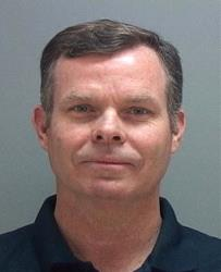 This Tuesday, July 15, 2014 photo shows former Utah attorney general John Swallow, who was booked on four felony charges.