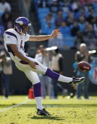 In this Oct. 30, 2011, photo, Minnesota Vikings' Chris Kluwe punts to the Carolina Panthers in Charlotte, NC.