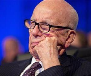 Businessman Rupert Murdoch watches as President Barack Obama speaks at the Wall Street Journal CEO Council annual meeting in Washington, Nov. 19, 2013.