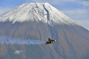 An aviator flies by Mount Fuji in Japan.