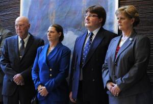In the image taken Oct. 24, 2011, John Wesley Walker, left, and his wife Princess Irina of Romania, center left, Alexander Phillips Nixon, center right, and Princess Elena of Romania attend the opening of an exhibition in Bucharest.