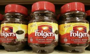 In this file photo, containers of Folgers instant coffee are seen on a supermarket shelf.