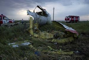 Fire engines arrive at the crash site of a passenger plane near the village of Grabovo, Ukraine.