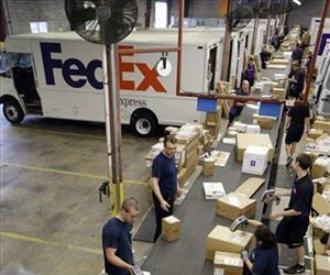 Workers sort packages at the FedEx Express station in Nashville, Tenn.