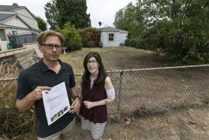 Michael Korte and his wife, Laura Whitney, pose outside their home in Glendora, Calif., on July 17, 2014.