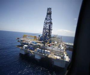 In a July 28, 2010 file photo, a deepwater rig is seen from Interior Secretary Ken Salazar's helicopter as he arrives to tour the rig in the Gulf of Mexico, off the coast of Louisiana.