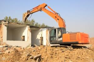 Demolishing a house in China.
