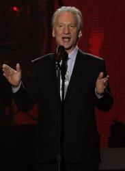 Bill Maher speaks on stage at the MusiCares Person of the Year gala honoring Barbra Streisand on Friday Feb. 11, 2011 in Los Angeles.