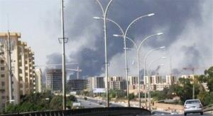 Smoke rises from earlier fighting at Tripoli's international airport.