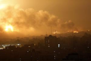 Smoke rises as flames spread across buildings after Israeli strikes in the Shijaiyah neighborhood in Gaza City today.