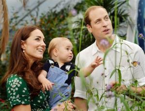 This photo released Monday, July 21, 2014, to mark Prince George's first birthday, shows Prince William and Kate Duchess of Cambridge and George during a visit to the Natural History Museum, London.