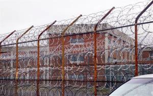 A security fence surrounds New York's Rikers Island correctional facility.