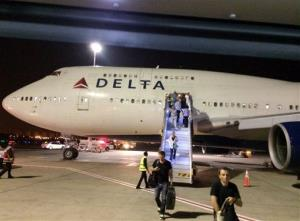 A New York-bound Delta plane at Ben Gurion Airport in Tel Aviv, Israel, after an emergency Sunday, July 13, 2014. Delta canceled all flights to Israel indefinitely today, citing reports of a rocket.
