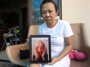 Christine holds a portrait of her fiance, Willem Grootscholten of the Netherlands, who was a passenger of the crashed Malaysia Airlines Flight 17.