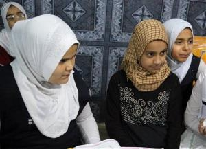 In this March 13, 2014, photo, girls study at an orphanage in Baghdad, Iraq.