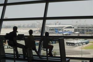 Israelis wait to board at Ben Gurion International airport in Tel Aviv.