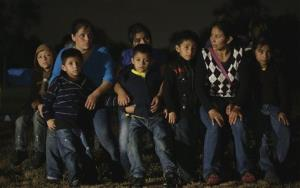 A group of  immigrants from Honduras and El Salvador who crossed the U.S.-Mexico border illegally are stopped June 25 in Granjeno, Texas.