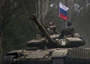A pro-Russian rebel looks up while ridding on a tank east of Donetsk this week.