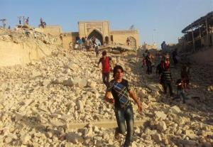 People walk on the rubble of the destroyed Mosque of The Prophet Younis, or Jonah, in Mosul yesterday.
