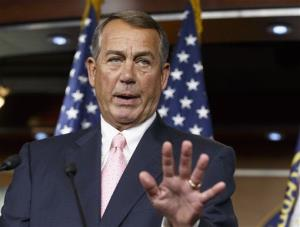 Speaker of the House John Boehner talks with reporters about the border crisis, veterans' health care, and future funding on Capitol Hill on July 24, 2014.