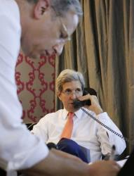 U.S. Secretary of State John Kerry talks to Israeli Prime Minister Benjamin Netanyahu about terms of a cease-fire in fighting in Gaza between Israel and Hamas, Friday, July 25, 2014, from his hotel suite in Cairo, Egypt. At left is Frank Lowenstein, acting special envoy for Israeli-Palestinian negotiations.