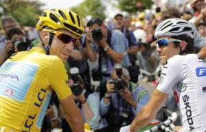 Italy's Vincenzo Nibali, wearing the overall leader's yellow jersey, and France's Thibaut Pinot, wearing the best young rider's white jersey, wait  for the start of the twenty-first and last stage of the Tour de France cycling race over 137.5 kilometers (85.4 miles) with start in Evry and finish...