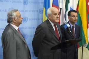 Palestinian UN Ambassador Riyad Mansour, center, speaks following a meeting of the UN Security Council on the situation in Gaza at UN headquarters on July 28, 2014.