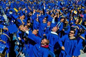 Graduates throw their caps in the air in triumph at the University of Delaware's commencement ceremony in Newark, Del., Saturday, May 31, 2014.